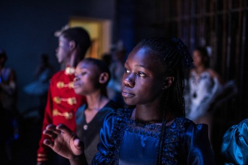 Pamela is watching and waiting for her turn to enter the stage during rehearsal for the nutcracker at the national theatre in Nairobi.