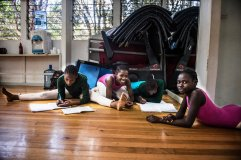 The dancers doing homeworks in between to keep up their grades, they know that good grades and the dance is two things that can take them out of Kibera one day