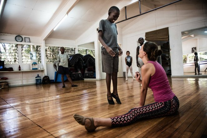Cooper Rust is the Artist director at Dance center Kenya, she says that even though the kids train in a small, old room and without shoes, there is really not much difference from the kids who train in her studio a few times a week, here she drilling Dickens, 13 in his dance