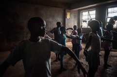 It is around 30 children in the class, even though the space is small they manage to dance without bumping into each other