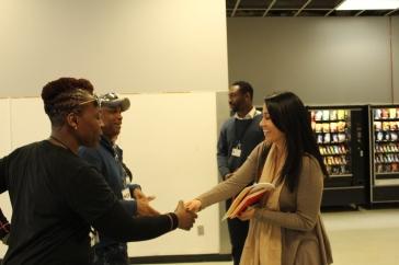 PSG Team greets URM's Pr Coordinator Alexandra Monsibaez.