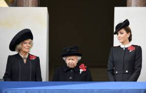 LONDON, ENGLAND - NOVEMBER 11: Camilla, Duchess of Cornwall, Queen Elizabeth II and Catherine, Duchess of Cambridge attend the annual Remembrance Sunday memorial at The Cenotaph on November 11, 2018 in London, England. The Armistice ending the First World War between the Allies and Germany was signed at Compiegne, France on eleventh hour of the eleventh day of the eleventh month - 11am on the 11th November 1918. This day is commemorated as Remembrance Day with special attention being paid for this yearÕs centenary. (Photo by Karwai Tang/WireImage)