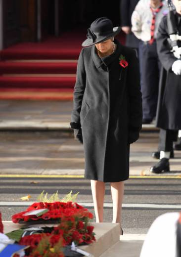 LONDON, ENGLAND - NOVEMBER 11: Teresa May lays a wreath during the annual Remembrance Sunday memorial at The Cenotaph on November 11, 2018 in London, England. The Armistice ending the First World War between the Allies and Germany was signed at Compiegne, France on eleventh hour of the eleventh day of the eleventh month - 11am on the 11th November 1918. This day is commemorated as Remembrance Day with special attention being paid for this yearÕs centenary. (Photo by Karwai Tang/WireImage)